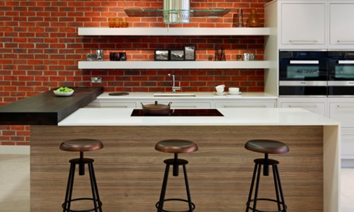 Harvey Jones kitchen with exposed brick wall