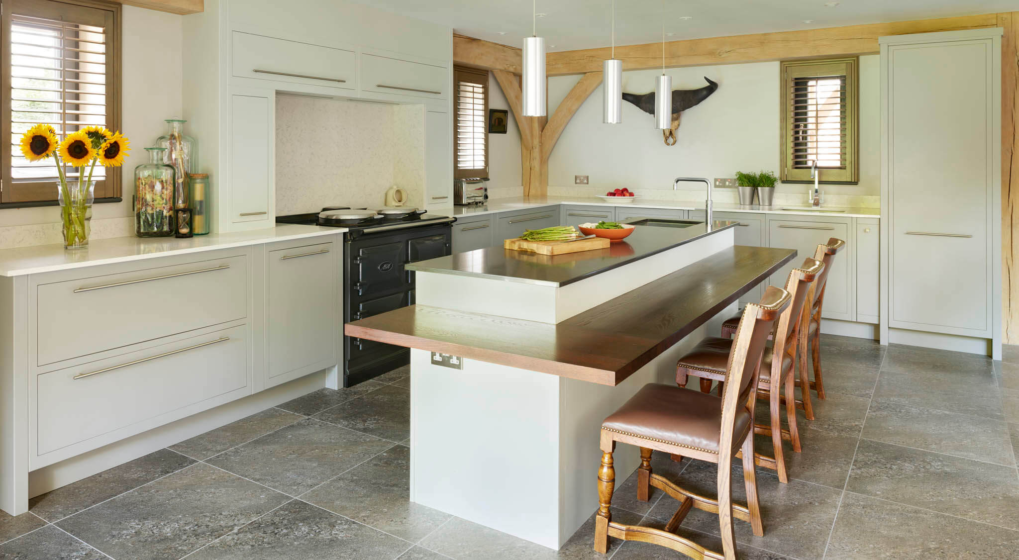 Linear Kitchen Design With Integrated Island Seating
