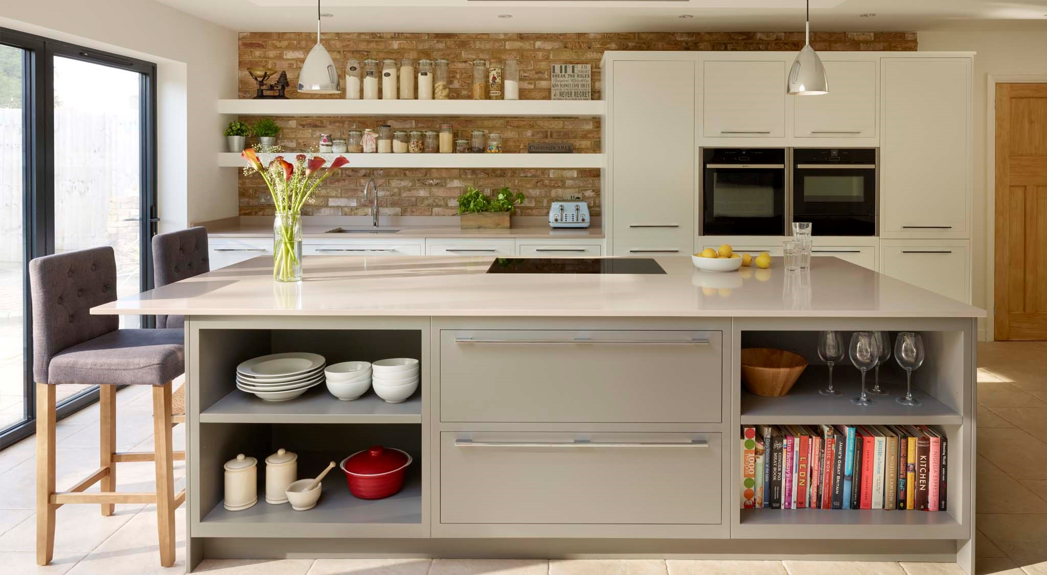 A two tone linear kitchen design with exposed brick wall for 2 wall kitchen designs
